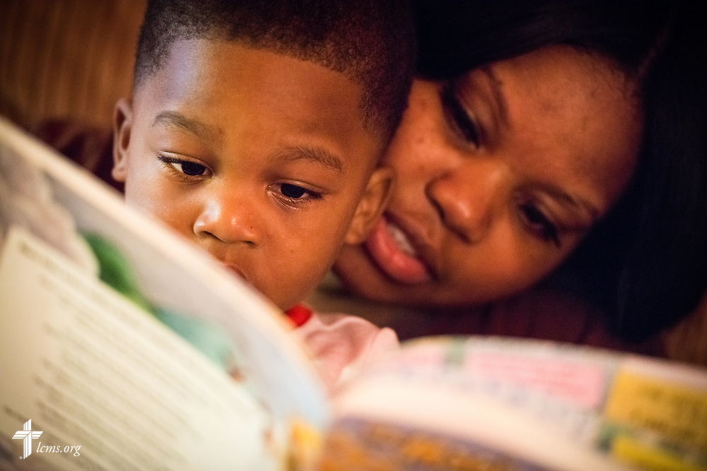 Resident Amber Norman and her son Amir Norman read together before bedtime at A Place of Refuge on Tuesday, Sept. 1, 2015, in Milwaukee, Wis. LCMS Communications/Erik M. Lunsford