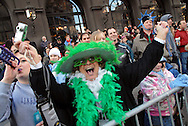 PHILADELPHIA - JANUARY 1:  Marlene Ertl, of Mount Ephraim, New Jersey cheers on the Mummers during the 107th Annual New Year's Day Mummer's Parade January 1, 2008 in Philadelphia, Pennsylvania. Thousands came out to watch the annual event as it paraded up Broad Street after a three hour rain delay..(Photo by William Thomas Cain/Getty Images)
