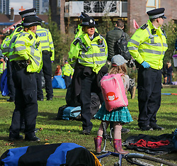 © Licensed to London News Pictures. 15/10/2019. London, UK. Police start to remove tents at the Extinction Rebellion camp in Lambeth Pleasure Park. Activists continue to occupy roads around Westminster for the 9th day after being evicted from their camp in Trafalgar Square. Photo credit: Alex Lentati/LNP