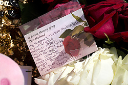 © London News Pictures. 26/05/2013. Woolwich, UK. A note on flowers reading 'In Loving Memory of my Devoted Husband' left by Rebecca 'Becky' Rigby, wife of Drummer Lee Rigby outside Woolwich Barracks in Woolwich town centre where her husband was murdered in what is being described as a terrorist attack. Photo credit: Ben Cawthra/LNP