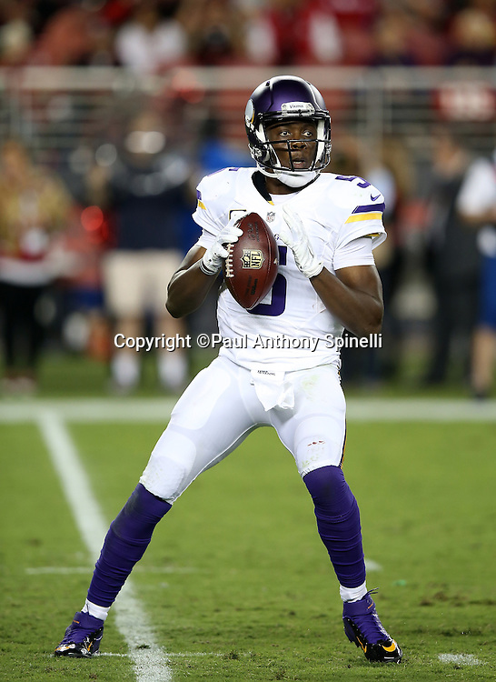 Minnesota Vikings quarterback Teddy Bridgewater (5) throws a pass during the 2015 NFL week 1 regular season football game against the San Francisco 49ers on Monday, Sept. 14, 2015 in Santa Clara, Calif. The 49ers won the game 20-3. (©Paul Anthony Spinelli)