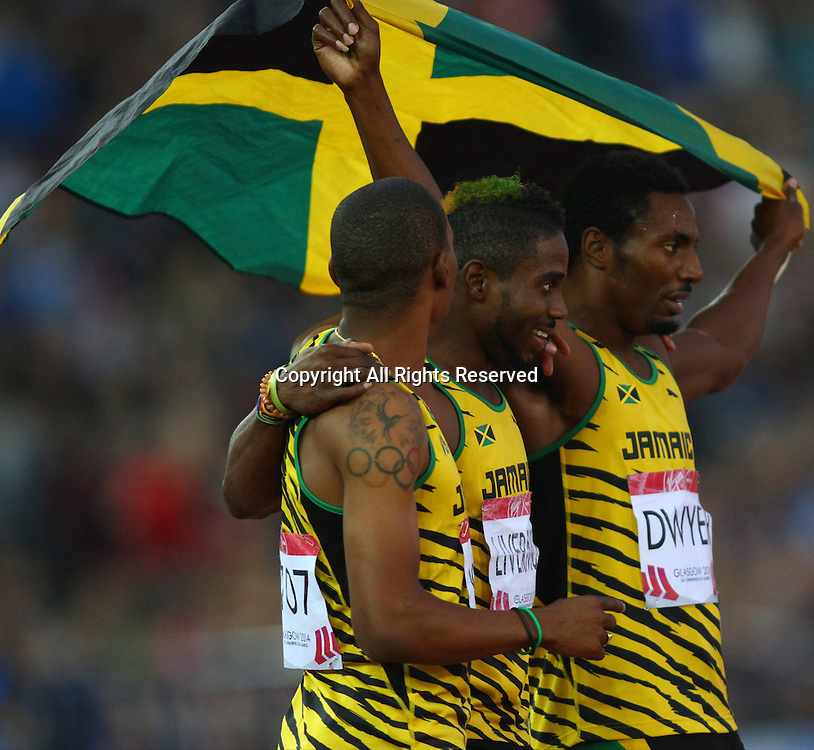 31.07.2014. Glasgow, Scotland. Glasgow Commonwealth Games. Men's 200m final from Hampden Park. Rasheed Dwyer, Warren Weir and Jason Livermore celebrate Jamaica winning gold, silver and bronze