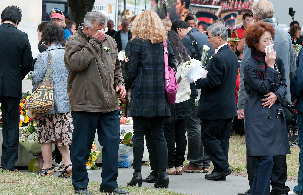 Flowers are brought to the memorial at the service to commemorate the second anniversary of the February earthquake,  Christchurch, New Zealand, Friday, February 22, 2013. Credit:  SNPA/ David Alexander.