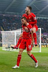 Jordan Henderson of Liverpool celebrates with Adam Lallana after scoring a goal to make it 0-1 - Photo mandatory by-line: Rogan Thomson/JMP - 07966 386802 - 16/03/2015 - SPORT - FOOTBALL - Swansea, Wales — Liberty Stadium - Swansea City v Liverpool - Barclays Premier League.