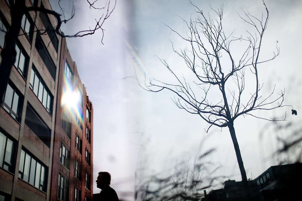 A visitor to the High Line Park gazes at an old meatpacking plant, New York.
