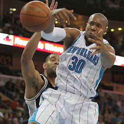 17 December 2008:  New Orleans Hornets forward David West (30) has the ball knocked away by San Antonio Spurs forward Tim Duncan (21) during a 90-83 victory by the New Orleans Hornets over the San Antonio Spurs at the New Orleans Arena in New Orleans, LA..