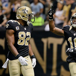 Dec 27, 2015; New Orleans, LA, USA; New Orleans Saints wide receiver Brandin Cooks (10) celebrates after a touchdown catch with tight end Benjamin Watson (82) during the second quarter of a game against the Jacksonville Jaguars at the Mercedes-Benz Superdome. Mandatory Credit: Derick E. Hingle-USA TODAY Sports