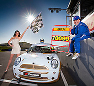 15:03:11. Miss Scotland 2010 Nicola Mimnagh with Kenneth McLeod who is a Scottish Mini Championship race driver putting up a £6K prize for CHAS of trip to Monte Carlo Grand Prix next May. He has his racing mini all decked out with CHAS logos... ..Pic:Andy Barr.07974 923919  (mobile).andy_snap@mac.com.All pictures copyright Andrew Barr Photography. .Please contact before any syndication. .