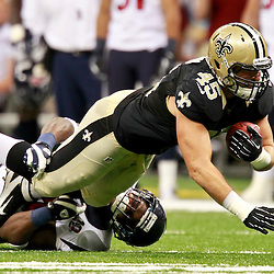 August 25, 2012; New Orleans, LA, USA; New Orleans Saints fullback Jed Collins (45) is tackled by Houston Texans linebacker Mister Alexander (54) during the first half of a preseason game at the Mercedes-Benz Superdome. Mandatory Credit: Derick E. Hingle-US PRESSWIRE