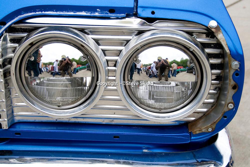 Twin headlight abstract of Chevy on display at Lowrider Car Show. Cinco de Mayo Fiesta St Paul Minnesota USA