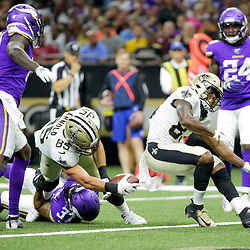 Aug 9, 2019; New Orleans, LA, USA; New Orleans Saints tight end Dan Arnold (85) scores past Minnesota Vikings defensive back Derron Smith (37) during the second quarter at the Mercedes-Benz Superdome. Mandatory Credit: Derick E. Hingle-USA TODAY Sports