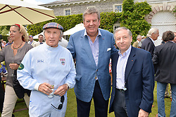 Left to right, SIR JACKIE STEWART, JOHANN RUPERT and JEAN TODT at the Cartier hosted Style et Lux at The Goodwood Festival of Speed at Goodwood House, West Sussex on 29th June 2014.