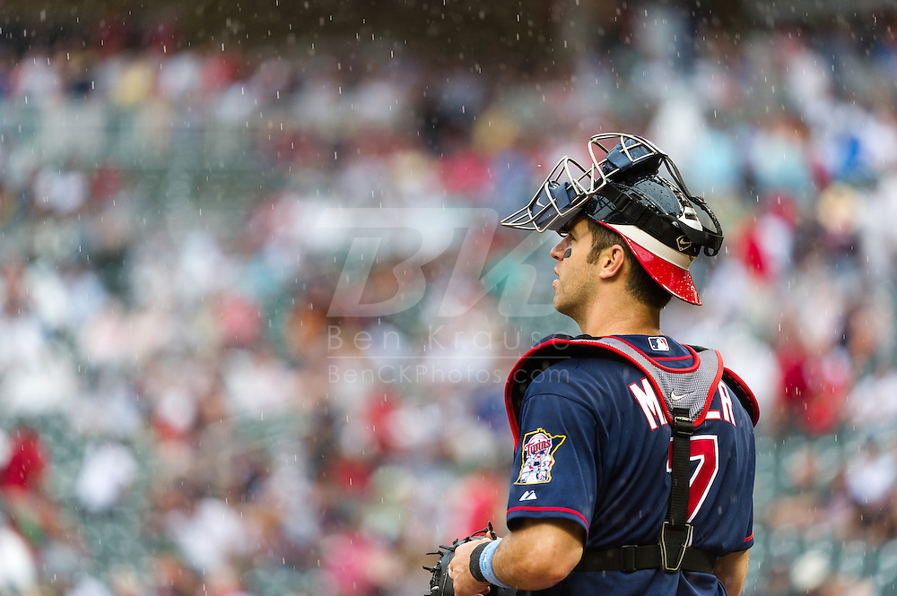 Minnesota Twins catcher Joe Mauer looks on during a game against the Milwaukee Brewers at Target Field in Minneapolis, Minnesota on June 17, 2012.  The Twins defeated the Brewers 5 to 4 in 15 innings.  The game was the longest in Target Field history.  © 2012 Ben Krause