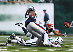 Sept 19, 2011; East Rutherford, NJ, USA; New England Patriots safety Pat Chung (25) tries to intercept a pass by New York Jets quarterback Mark Sanchez (6) during the 1st half at the New Meadowlands Stadium.