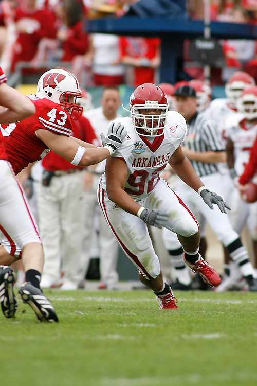 University of Arkansas defensive lineman Jamaal Anderson runs past University of Wisconsin tight end Andy Crooks during the Wisconsin Badgers 17-14 victory over the Arkansas Razorbacks in the Capital One Bowl at the Florida Citrus Bowl Stadium in Orlando, Florida on January 1, 2007.