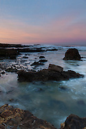 Pastel oranges and aquas emerge at sunrise, Pescadero State Beach, California