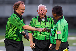 Soccer referee Aubrey Cashman, center, greets colleague linesman Henry Woo, right, and Frank LaBoone after a soccer match between Lexington Catholic and Henry Clay, Tuesday, Aug. 13, 2013 at Lexington Catholic Soccer/Football Stadium in Lexington. Photo by Jonathan Palmer