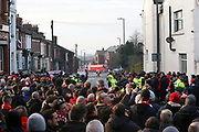 Liverpool fans await in anticipation as the Team Bus turns into Anfield Road for the Premier League match between Liverpool and Manchester United at Anfield, Liverpool, England on 19 January 2020.