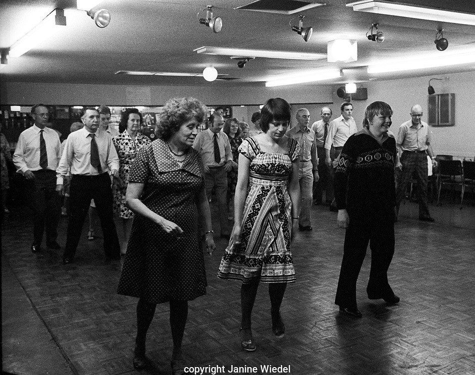 Learning new steps at evening dance class in  a bar in Stoke-on-Trent in 1970s