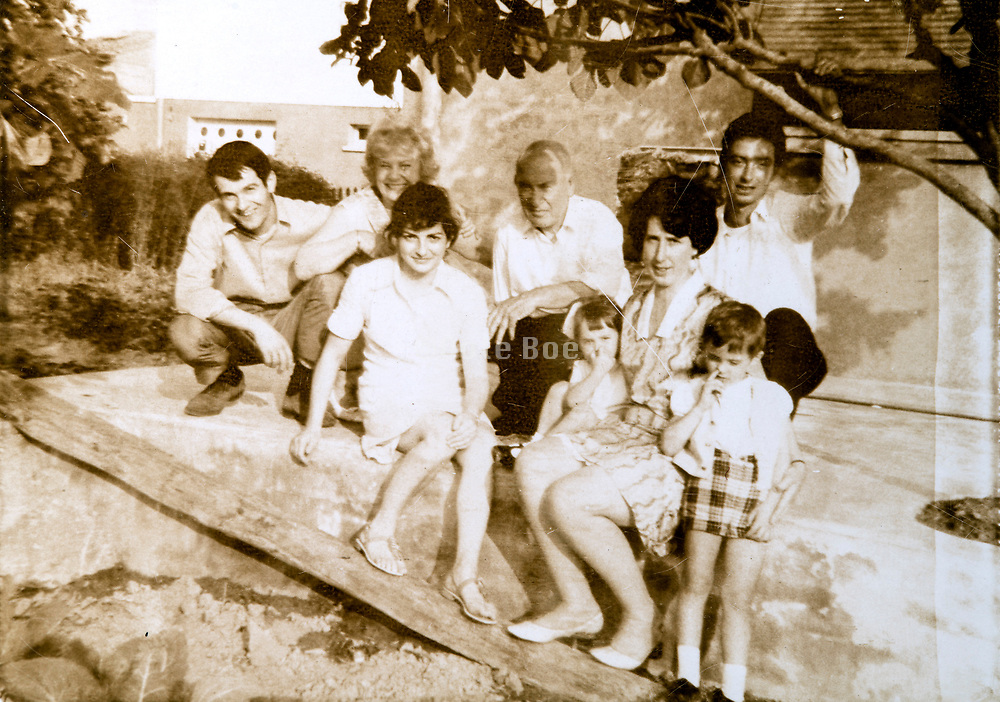 large family group posing in backyard France ca 1970s