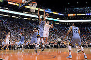 Mar 21, 2016; Phoenix, AZ, USA; Phoenix Suns forward Mirza Teletovic (35) shoots the ball against Memphis Grizzlies center Ryan Hollins (20) and guard Vince Carter (15) in the first half at Talking Stick Resort Arena. Mandatory Credit: Jennifer Stewart-USA TODAY Sports