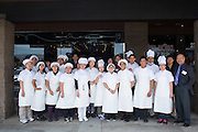 The chefs and staff of Paris Baguette Cafe pose with Milpitas Mayor Jose Esteves, right, during the Grand Opening Ribbon Cutting Ceremony at Paris Baguette Cafe in Milpitas, California, on May 16, 2014. Paris Baguette created more than 30 new jobs for Milpitas locals. (Stan Olszewski/SOSKIphoto)