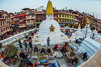 Tibetan Buddhists prostrating themselves, Boudhanath Temple, Kathmandu, Nepal. It is the largest stupa in Nepal and the holiest Tibetan Buddhist temple outside Tibet. It is the center of Tibetan culture in Kathmandu.