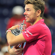 2016 U.S. Open - Day 14  Stan Wawrinka of Switzerland celebrates with the trophy after winning the Men's Singles Final against Novak Djokovic of Serbia on Arthur Ashe Stadium on day fourteen of the 2016 US Open Tennis Tournament at the USTA Billie Jean King National Tennis Center on September 11, 2016 in Flushing, Queens, New York City.  (Photo by Tim Clayton/Corbis via Getty Images)