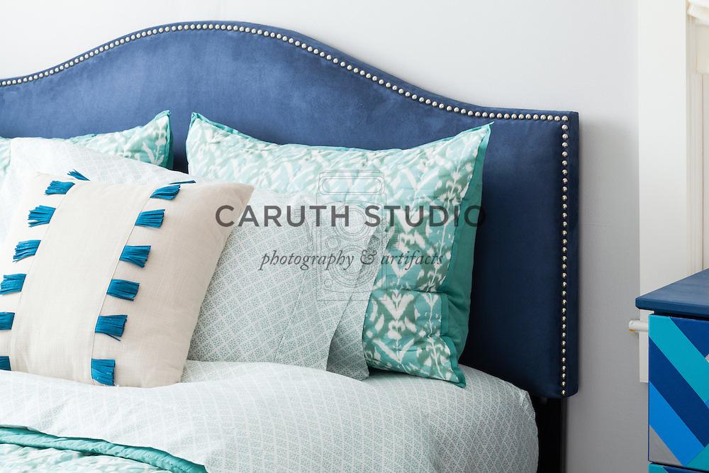 One Dresser Three Ways: Blue bedroom linens and headboard