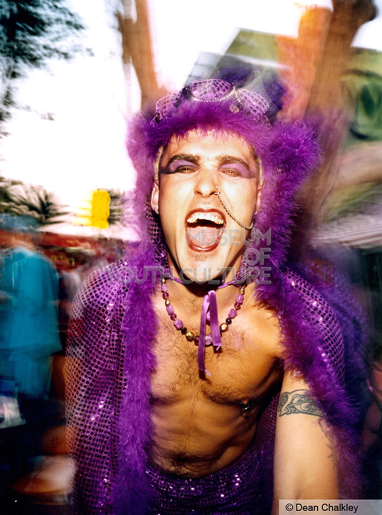 Man having a good time wearing purple mirrored costume at club in Ibiza 1999.