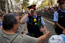August 26, 2017 - Barcelona, Catalonia, Spain - In Barcelona catalan police officers receive roses and greetings during a march against terror attacks.  Half a million people have demonstrated through  streets under the slogan We Are Not Afraid  after that a terror attack in Las Ramblas of Barcelona and in the village of Cambrils killed 15 people last week (Credit Image: © Jordi Boixareu via ZUMA Wire)