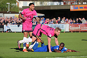 AFC Wimbledon striker Tom Elliott (9) getting fouled by Southend United defender Adam Thompson (5) during the EFL Sky Bet League 1 match between AFC Wimbledon and Southend United at the Cherry Red Records Stadium, Kingston, England on 25 March 2017. Photo by Matthew Redman.