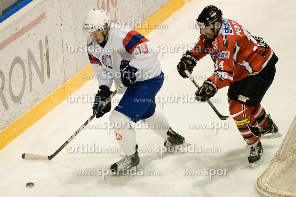 Tommy Kristiansen (Norway, #19) vs Markus Peintner (Austria, #34) during ice-hockey match between Norway and Austria in European Ice Hockey Challenge, on December 16, 2010 at Podmezaklja hall, Ljubljana, Slovenia. (Photo By Matic Klansek Velej / Sportida.com)