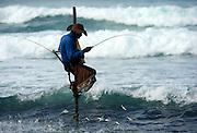 Stilt fisherman at dawn, Unawatuna, near Galle, Sri Lanka