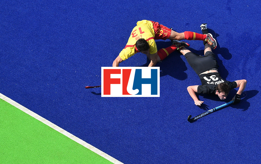 Spain's Andres Mir falls over New Zealand's Hayden Phillips during the men's field hockey New Zeland vs Spain match of the Rio 2016 Olympics Games at the Olympic Hockey Centre in Rio de Janeiro on August, 9 2016. / AFP / MANAN VATSYAYANA        (Photo credit should read MANAN VATSYAYANA/AFP/Getty Images)