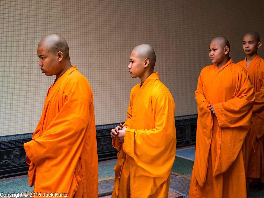 """07 FEBRUARY 2016 - BANGKOK, THAILAND: Mahayana novices (young monks) at Wat Mangon Kamlawat, perform a religious ceremony for Chinese New Year. Chinese New Year, also called Lunar New Year or Tet (in Vietnamese communities) starts Monday February 8. The coming year will be the """"Year of the Monkey."""" Thailand has the largest overseas Chinese population in the world; about 14 percent of Thais are of Chinese ancestry and some Chinese holidays, especially Chinese New Year, are widely celebrated in Thailand.        PHOTO BY JACK KURTZ"""