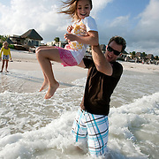 Brian Gay, 2008 champion of the Mayakoba Golf Classic at Riviera Maya-Cancun, a PGA Tour tournament held along the Caribbean in the Riviera Maya, enjoys time with his family on the beach including his wife, Kimberly, and daughters Makinley Kathryn 9, and Brantley Olivia, 5.