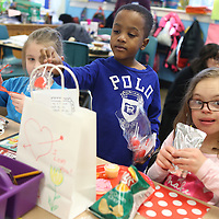 Lauren Wood   Buy at photos.djournal.com<br /> Will Spencer puts a sucker in his classmate Ava Credille's bag as he passes out valentines during the Valentine's Day party Friday afternoon in Carol Elliott's first grade classroom.
