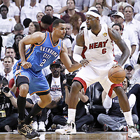 19 June 2012: Oklahoma City Thunder shooting guard Thabo Sefolosha (2) defends on Miami Heat small forward LeBron James (6) during the first quarter of Game 4 of the 2012 NBA Finals, Thunder at Heat, at the AmericanAirlinesArena, Miami, Florida, USA.