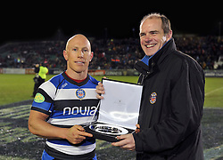 Peter Stringer is presented with an award to commemorate 100 European Rugby appearances, by Bath Rugby CEO Nick Blofeld - Photo mandatory by-line: Patrick Khachfe/JMP - Tel: Mobile: 07966 386802 16/01/2014 - SPORT - RUGBY UNION -  The Recreation Ground, Bath - Bath Rugby v Bordeaux-Begles - Amlin Challenge Cup.
