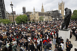 © Licensed to London News Pictures. 03/06/2020. London, UK. Members of the campaign group Black Lives Matter and supporters, gather outside Parliament, central London to demonstrate, following the death of African American George Floyd while in police custody. The death of George Floyd, who died after being restrained by a police officer In Minneapolis, Minnesota, has caused widespread rioting and looting across the USA. Photo credit: Peter Macdiarmid/LNP