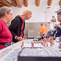 052413       Cable Hoover<br /> <br /> Jewelry marker Ola Eriacho, right, explains traditional Zuni jewelry and designs to Foster Delahoussaye, center, and Sandy Clark during the Annual Zuni Festival of Arts and Culture at the Museum of Northern Arizona in Flagstaff, Ariz. Saturday.