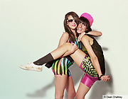 Betty and her friend hugging and posing, wearing fluorescent leotards, Southend, UK 2006