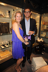 MAX KONIG and his wife JULIA at an exclusive viewing of Martyn Lawrence Bullard's furniture at Guinevere Antiques, 578 King's Road, London on 27th September 2010.