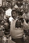Man selling metal lanterns