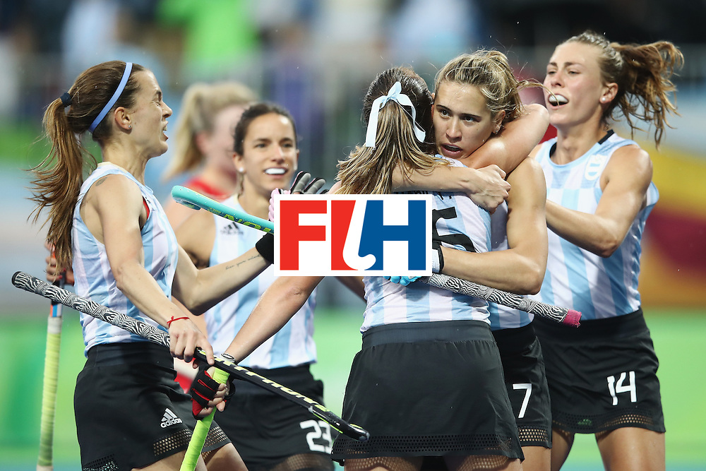 RIO DE JANEIRO, BRAZIL - AUGUST 10:  Florencia Habif of Argentina is congratulated by her team after scoring a goal during the women's pool B match between Great Britain and Argentina on Day 5 of the Rio 2016 Olympic Games at the Olympic Hockey Centre on August 10, 2016 in Rio de Janeiro, Brazil.  (Photo by Mark Kolbe/Getty Images)