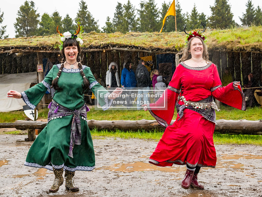 Pictured: Treubh Dannsa or Dance Tribe at Duncarron Medieval Village Opening. Carron Valley Forest, Lanarkshire, 18 May 2019. In authentic Scottish weather and mud, The Clanranald Trust opens a full-scale replica of an early Medieval Fortified Village typical of a Scottish Clan Chief's residence. The open air museum includes traditional buildings such as round houses, a great hall, and tower. The event features music bands and traditional dance.<br /> Sally Anderson   EdinburghElitemedia.co.uk