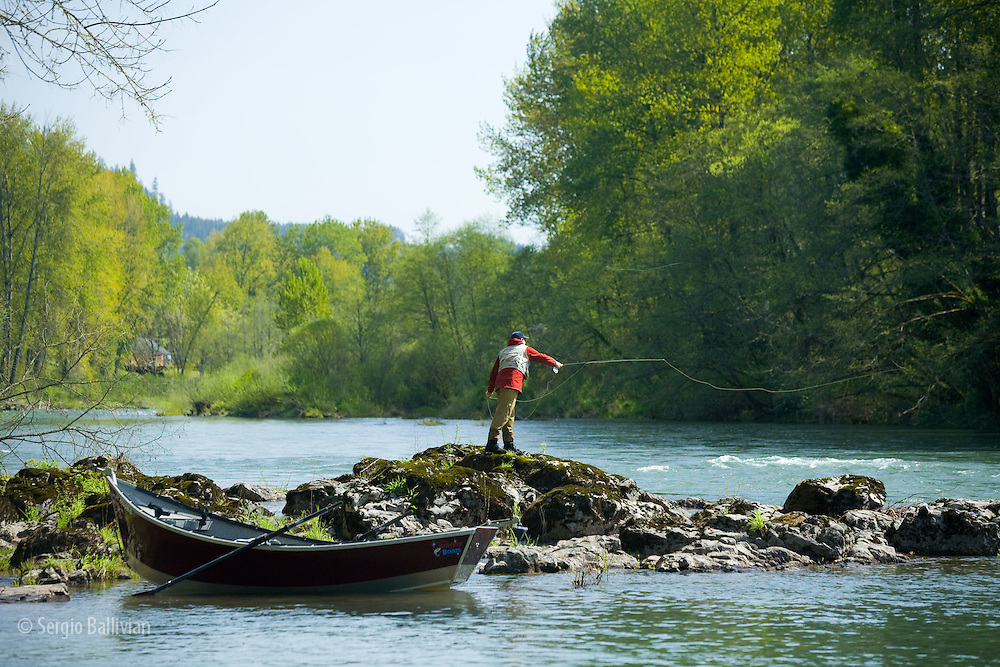 A mature man fly fishing on the Santiam River in Oregon