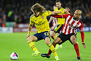 Arsenal defender David Luiz (23) under pressure from Sheffield United forward David McGoldrick (17) during the Premier League match between Sheffield United and Arsenal at Bramall Lane, Sheffield, England on 21 October 2019.