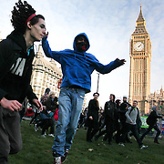 Thousands of students and protesters took to the streets of London on the day of the vote on rise in tuition fees in the House of Commons. The fences around Parliament are down and people surge in onto the grass.